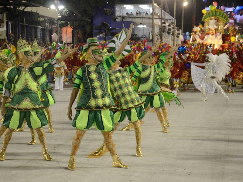 People In Costume Dancing At Carnival