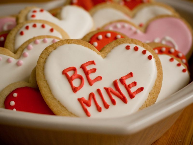 Valentine's Day Heart Shaped Cookies with red, white, and pink icing and messages of love.