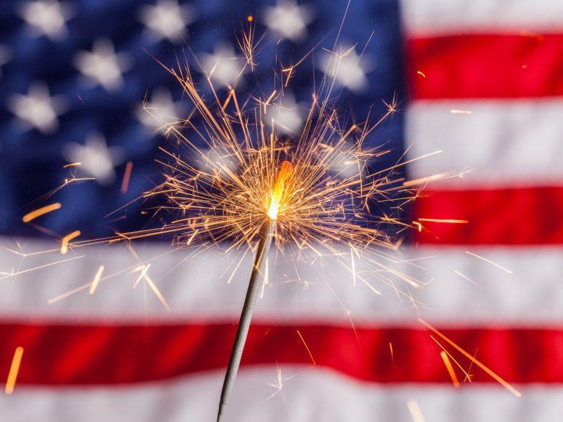 Sparkler Against American Flag Background