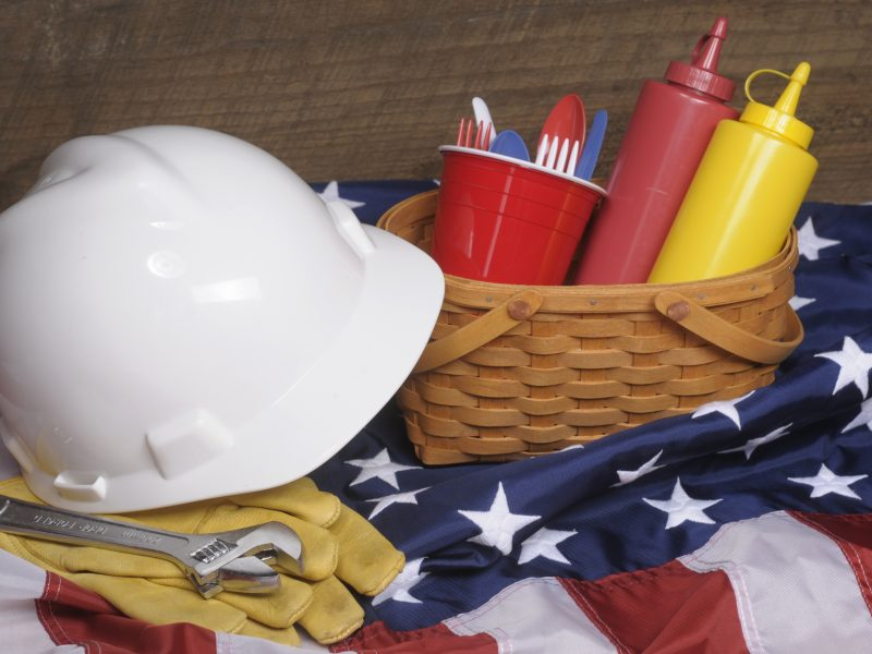 Stock photo of Labor Day Picnic with hardhat and tools